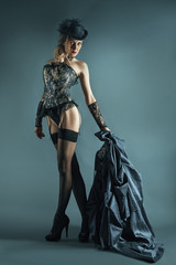 young girl in black stockings and corset