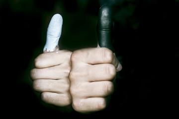 Black and white colored thumbs.Concept of genderinequality.