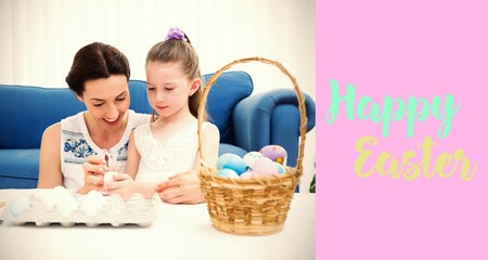 Composite image of mother and daughter painting easter eggs