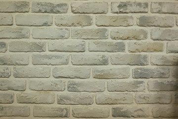 beige tan color of bricks cement wallpaper background textured:modern sepia brickwork concrete wall:stucco backdrop interior.rough and grain stone wallpaper concept.cropped frame display picture.