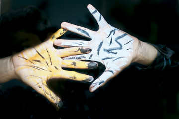 Human hand painted with poster color.