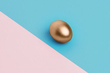 golden egg on the blue and pink background