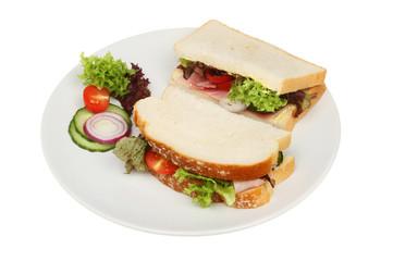 White bread ham sandwich on a plate