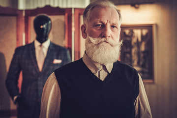 Senior client in a tailor's workshop