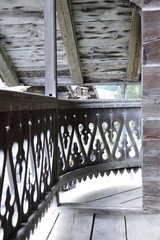 Balcony in gray carved wood of an old swiss chalet