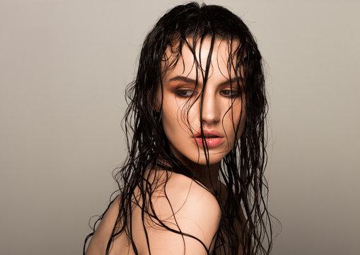 Beauty fashion model girl natural makeup wet hair