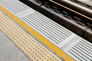 Blind floor tiles on train station platform