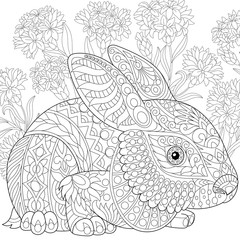 Stylized rabbit (bunny, hare) and cornflowers. Freehand sketch for adult anti stress coloring book page with doodle and zentangle elements.