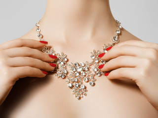 Elegant fashionable woman with jewelry. Beautiful woman with diamond necklace. Young beauty model with manicured nails. Jewellery and accessories. Fashion and beauty salon. Perfect lip makeup