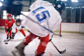 Little boy playing ice hockey.