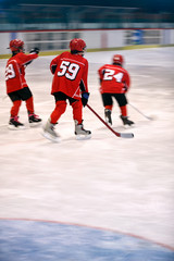 boys play ice hockey.