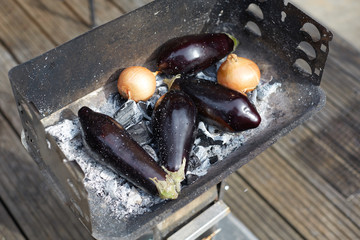 roasted aubergines and onions in a brazier