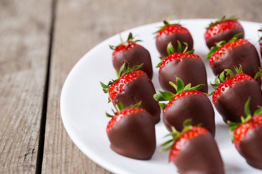 strawberries dipped in chocolate sauce.