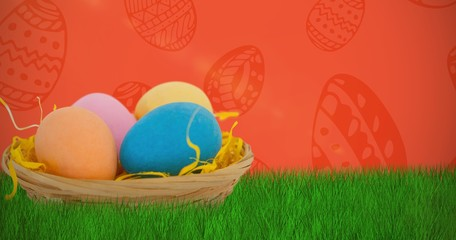 Composite image of colorful easter eggs in wicker basket