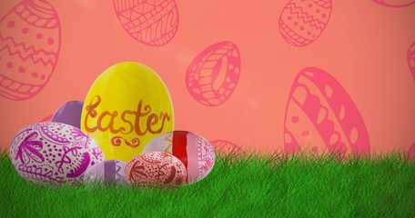 Composite image of multi colored patterned easter eggs