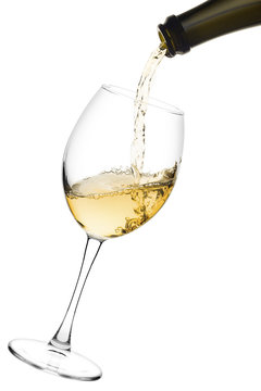 white wine poured from a bottle into wine glass on white background, isolated