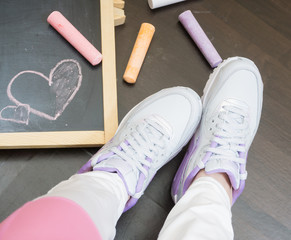 Modern sport shoes demonstrated in unique way with different objects