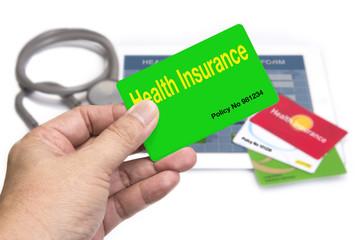 Wall Mural - Hand holding health insurance card.