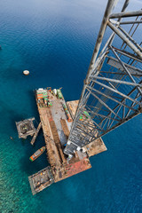 Aqaba, Jordan, 10/10/2015, Metal and concrete Jetty foundation construction at the Aqaba new port photographed from above