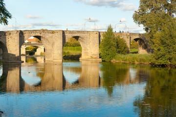 Ancient stone bridge across Aude River in Carcassonne South France.