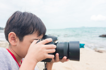 Taking and shooting  on the beach travel scene