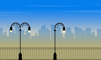 Scenery street lamp with city background of silhouettes