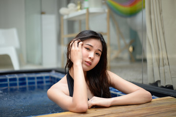 sexy asian woman in black one piece bikini