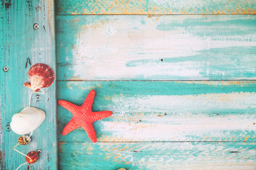 Summer background - starfish, shells, coral on wood table background.  vintage color tone styles.