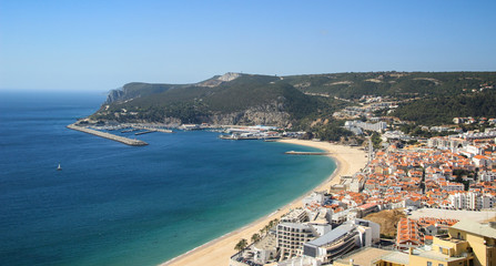 Beautiful view of Sesimbra beach in Portugal at the sunset