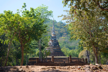 Landscape with the ruins of an ancient Buddhist temple Wat Chedi Ngarm. The surrounding area of Sukhothai city, Thailand