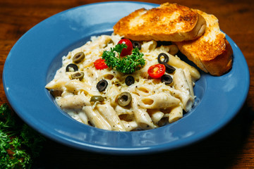 pasta with olives cherry tomatoes and cheese
