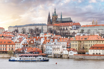 Panoramic view of Vltava river in Prague with tourist ship