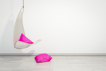 hanging armchair with pink pillows