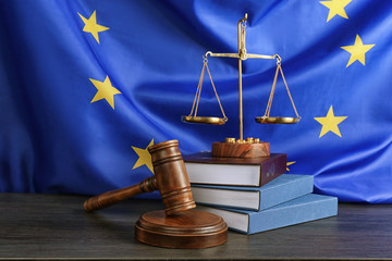 Obraz Judge gavel and books with scales on European Union flag background - fototapety do salonu