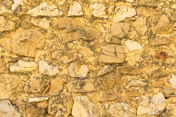 A background of a stone with orange tone