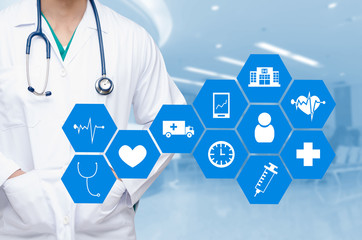 smart doctor with a stethoscope around his neck on the hospital blurred and health care and icon in hexagonal shaped pattern background, health care and medical technology concept