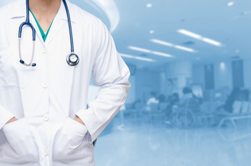 smart doctor with a stethoscope around his neck on the hospital blurred background, healthcare medical technology concept, copy space.