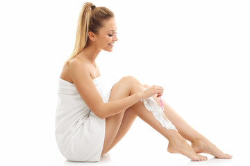 Woman shaving her legs isolated on white