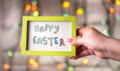 Hand holding Happy Easter card