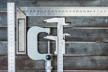 Measuring tools, metal background. Background, texture.