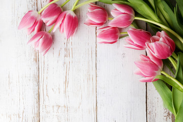 beautiful tulips on wooden background. Top view