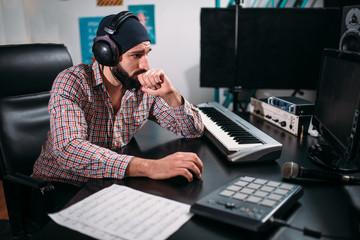 Audio engineer in headphones work in studio