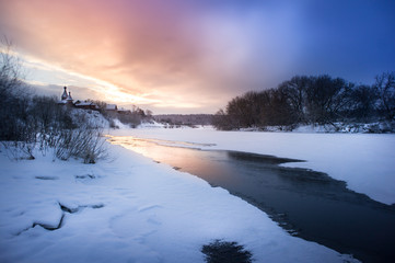 Winter sunrise in forest and river near the russian orthodox church, fantastic winter nature landscape, wallpaper