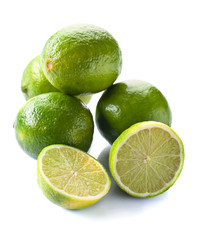 Group of whole and cut fresh limes over white background