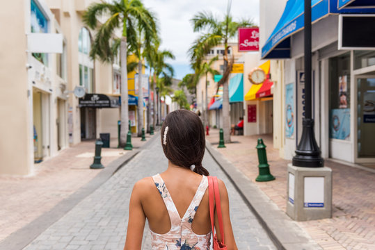 Woman tourist walking in shopping streets of Philipsburg, St Maarten, popular port of call for cruise ship travel destination. Caribbean tropical getaway.