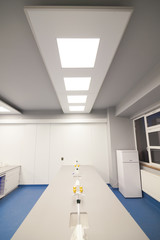 Interior of clean modern white medical, chemical or research room background.