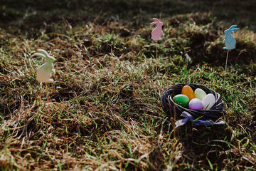 Easter eggs and bunnies in grass. Festive decoration for a Happy Easter.