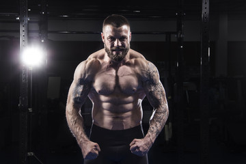 The portrait of brutal muscular athlete preparing and concent