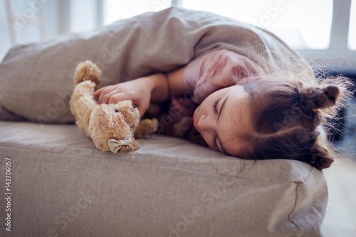 ed7cf602649e Cute little girl sleeping with teddy bear in bed