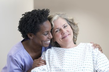 Nurse comforting female patient